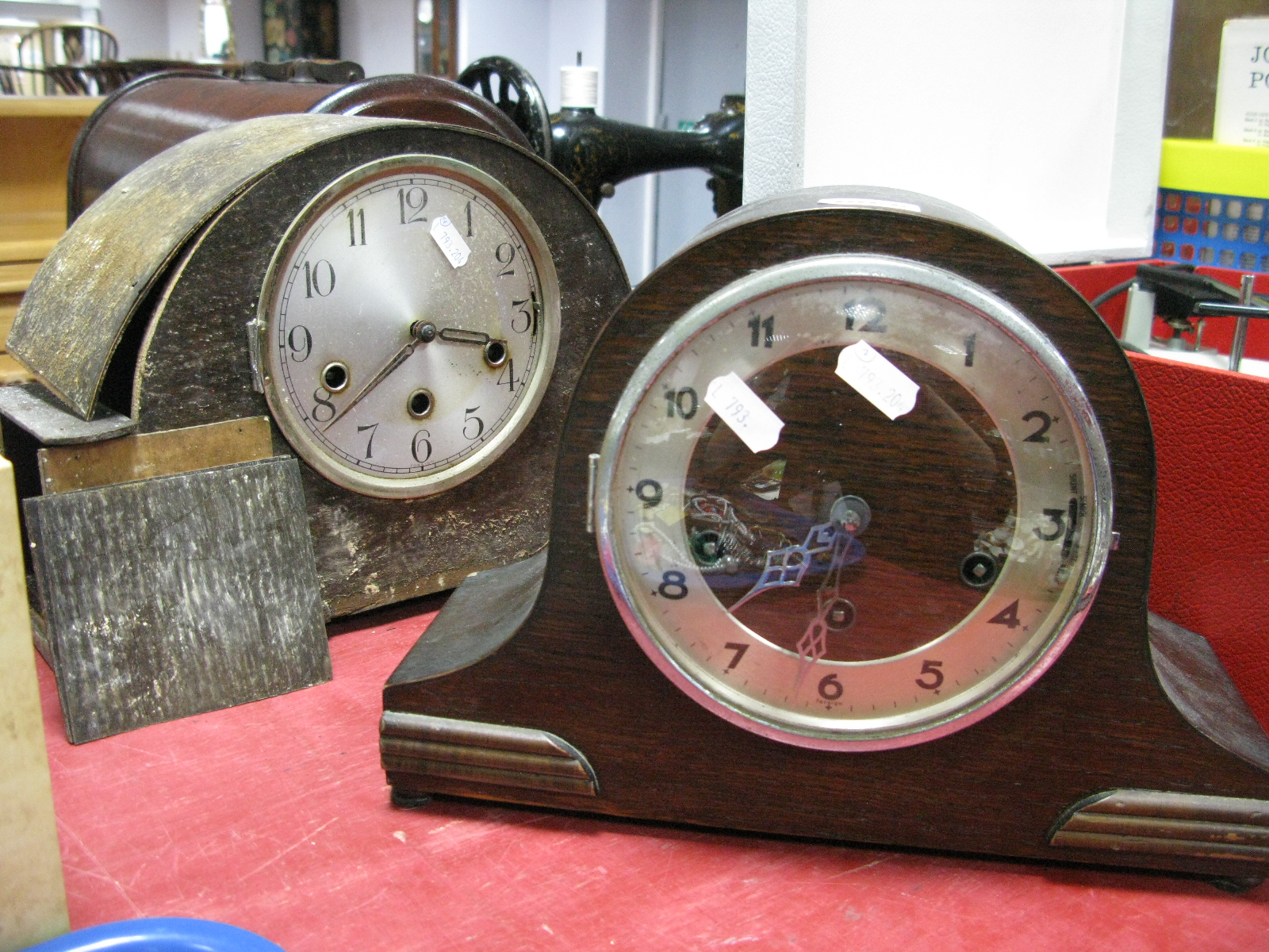 Lot 1066 - A 1920's Oak Cased Mantel Clock, with a silvered dial; together with one other clock. (2)