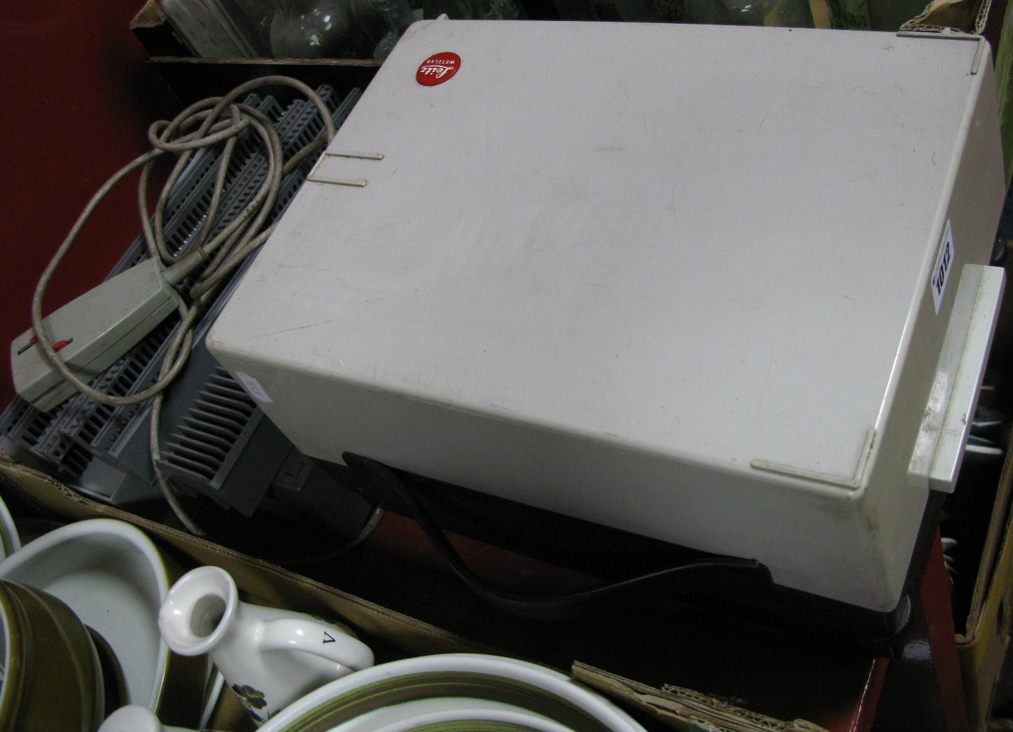 Lot 1012 - A Leitz (Leica) Slide projector, pradovit 250 with six magazine.