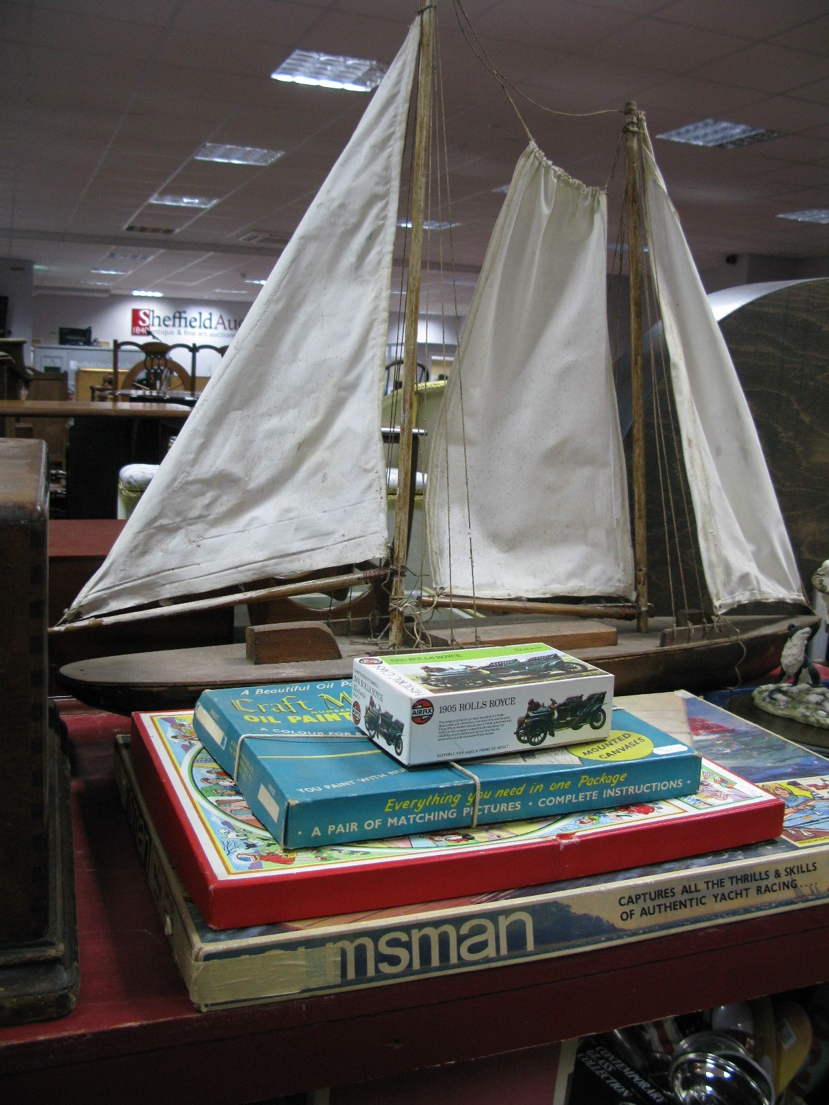Lot 1058 - A Child's Wooden Sailing Boat, canvas sails, length 93cm, Triang 'Helmsman' game, Airfix 1905