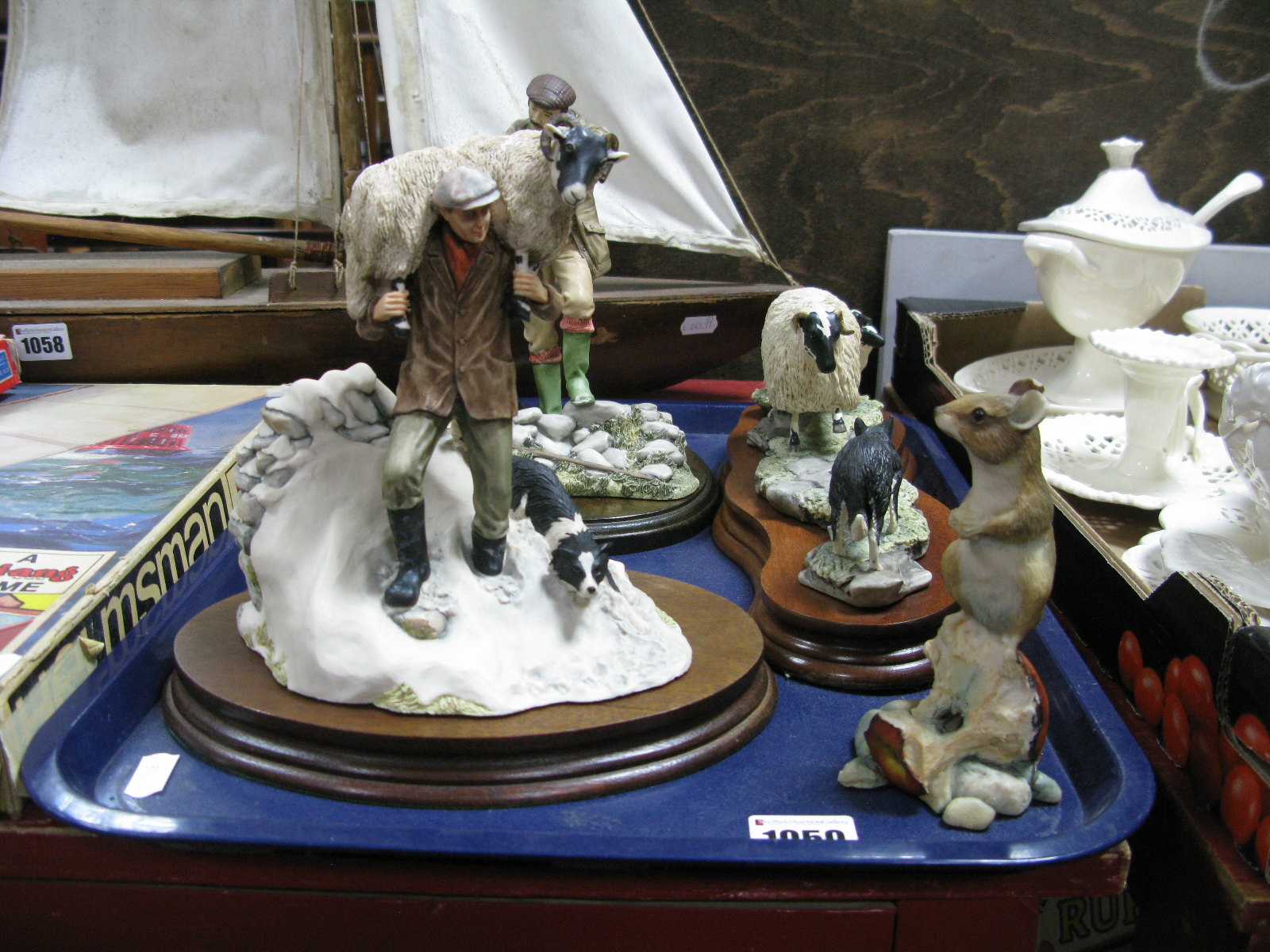 """Lot 1059 - Border Fine Arts 'Black Faced Ewe and Collie', """"Winter Rescue"""" and one other of farmer feeding a"""