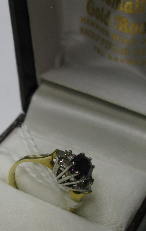 Lot 1370 - An 18ct Gold Diamond Set Dress Ring, oval claw set to the centre between diamond set shoulders.
