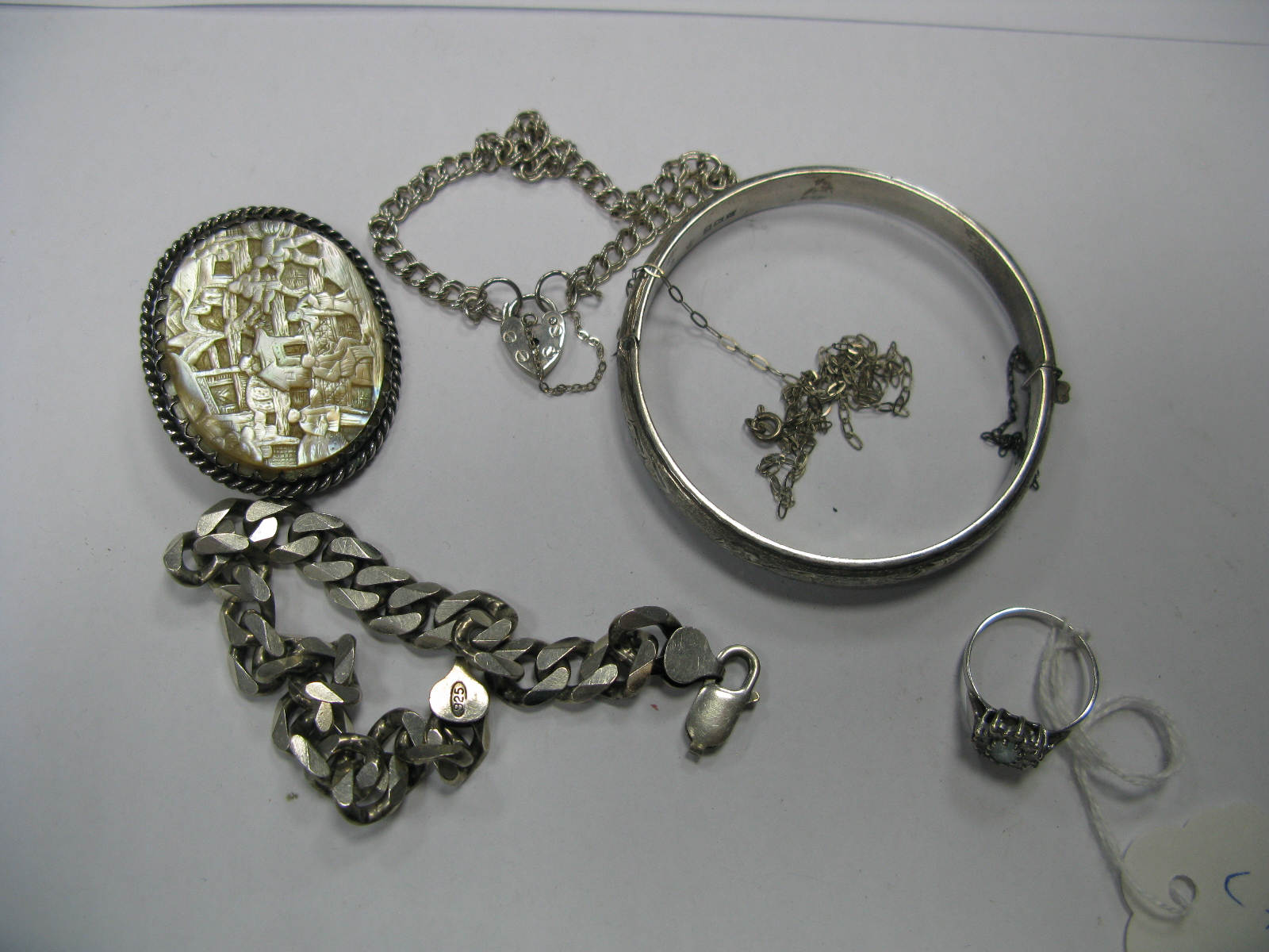 Lot 1407 - Decorative Mother of Pearl Brooch, a hallmarked silver bangle, bracelets and a 9ct white gold