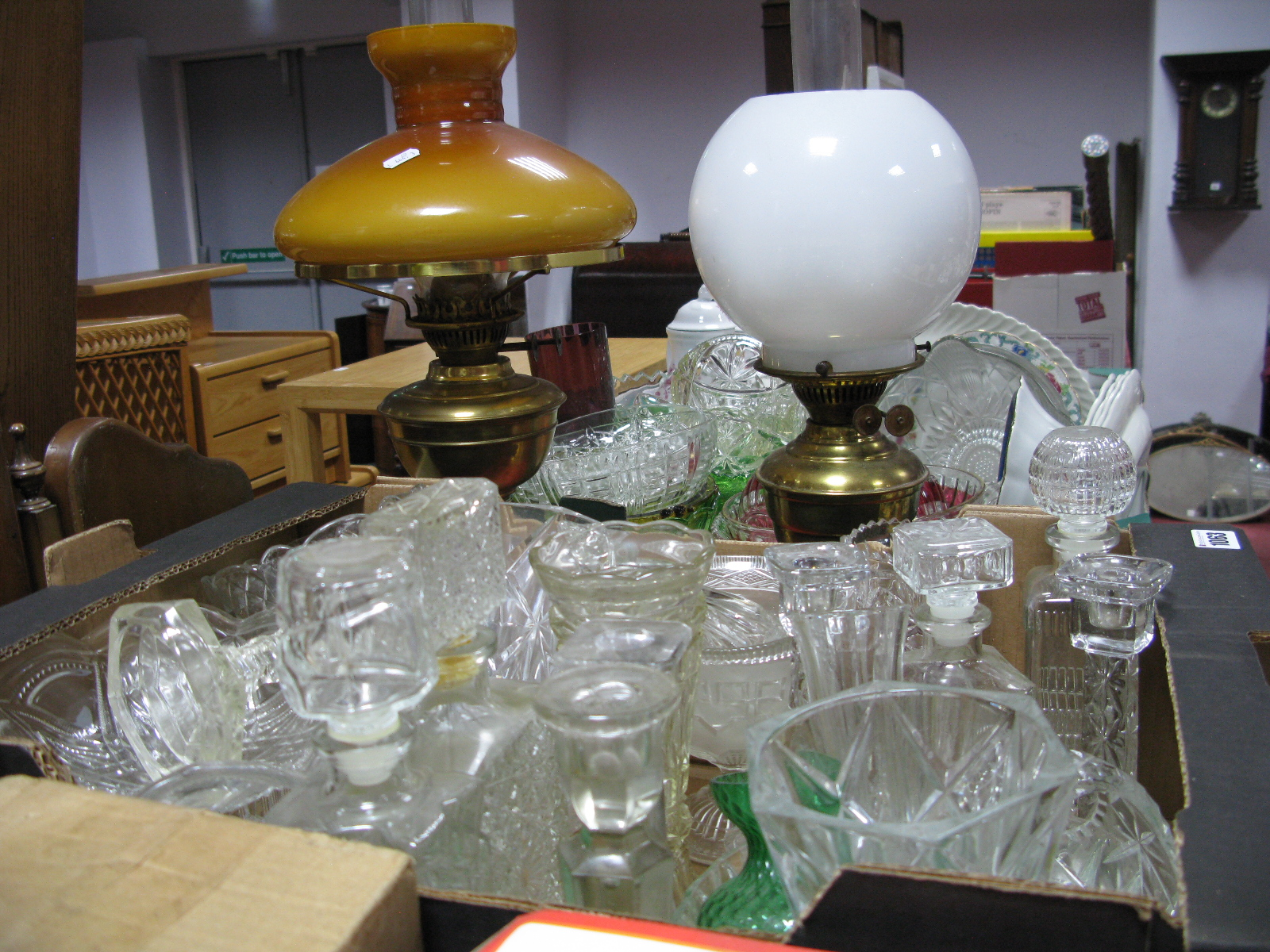 Lot 1063 - Decanters, other glassware:- One Box two brass oil lamps.