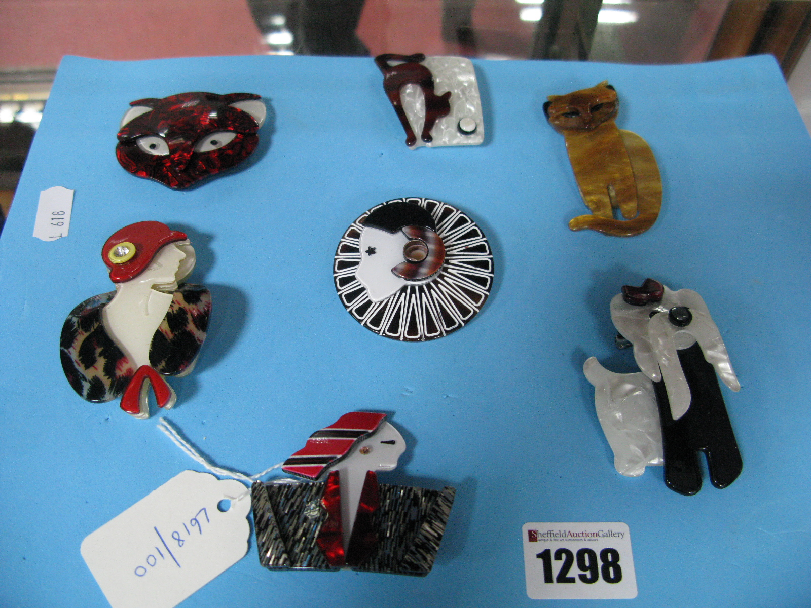 Lot 1298 - Seven Modern Costume Brooches.