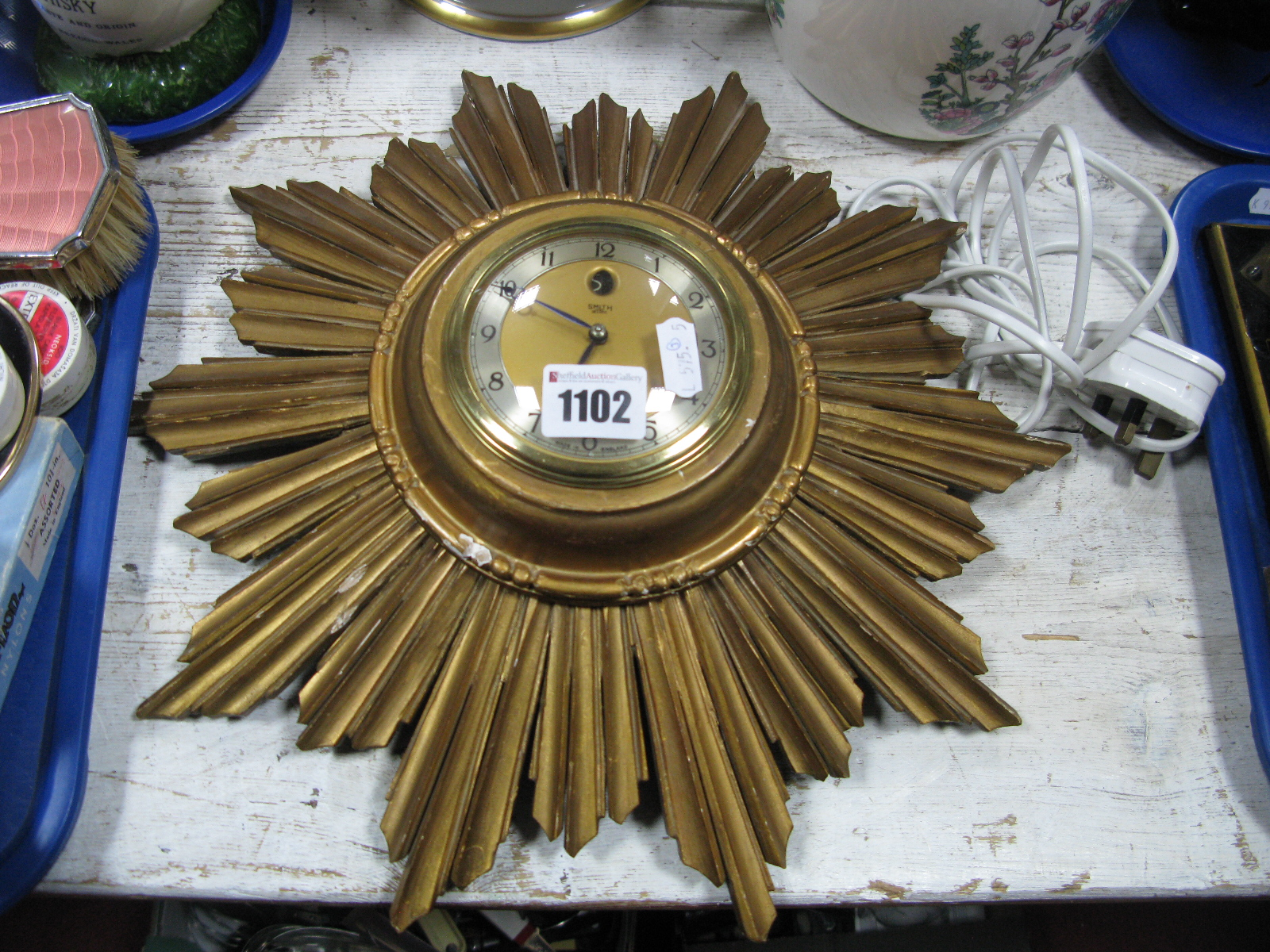 Lot 1102 - Portuguese Jardiniere, Indian Tree jar, motor cycle posters, sunburst wall clock by Smiths.