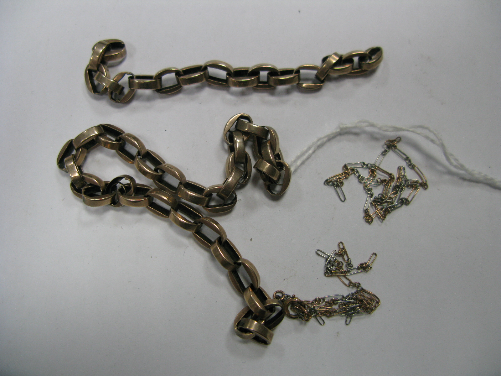 Lot 1390 - A Part Chain, (damaged), together with a fine two colour chain.