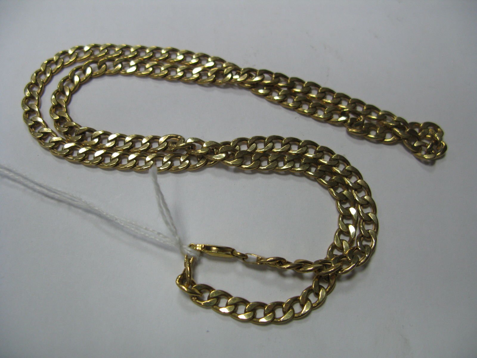 Lot 1373 - A 9ct Gold Curb Link Chain, of uniform design.