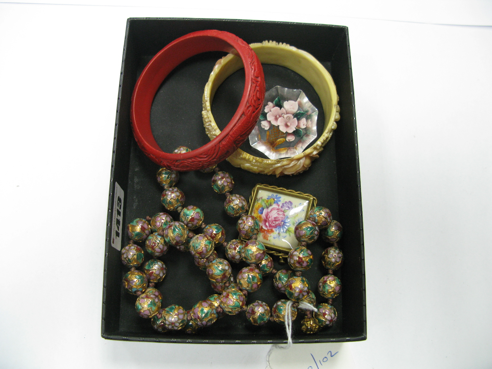 Lot 1413 - A Decorative Single Strand Cloisonné Bead Necklace, of uniform design, to oval snap clasp, bangles