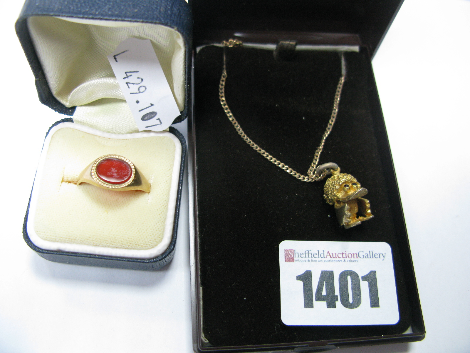 Lot 1401 - A 9ct Gold Hardstone Inset Signet Ring; together with a 9ct gold novelty charm pendant on a chain.
