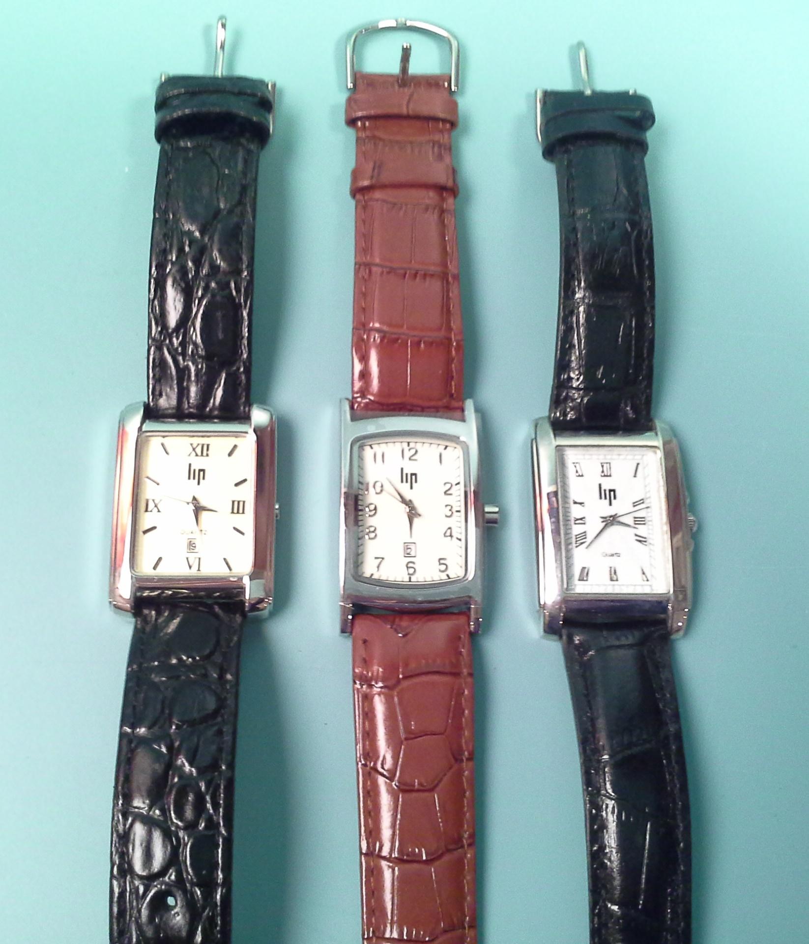 lip trois montres d homme de ville rectangulaires en acier bracelet cuir mouvement quartz. Black Bedroom Furniture Sets. Home Design Ideas