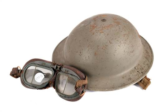 A WWII military Brodie helmet, having leather liner and chin strap