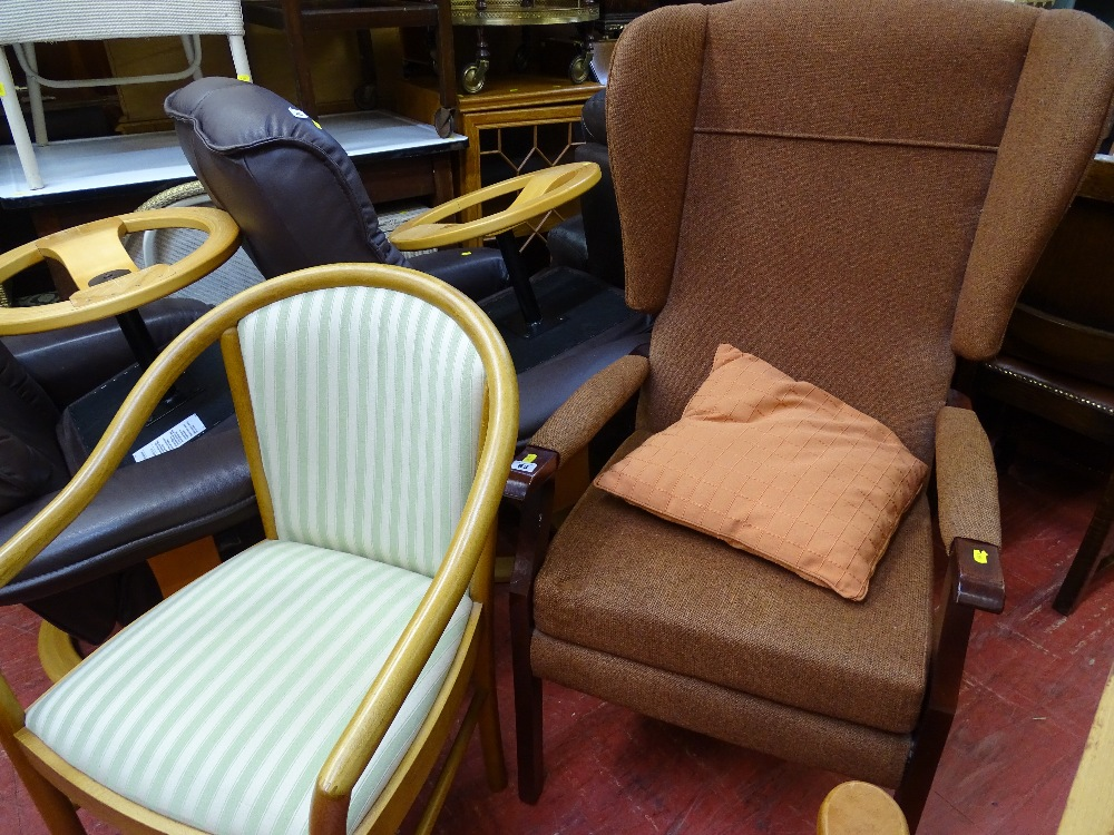 Lot 83 - Modern wingback armchair in tweed effect upholstery and a bow back wooden framed side chair