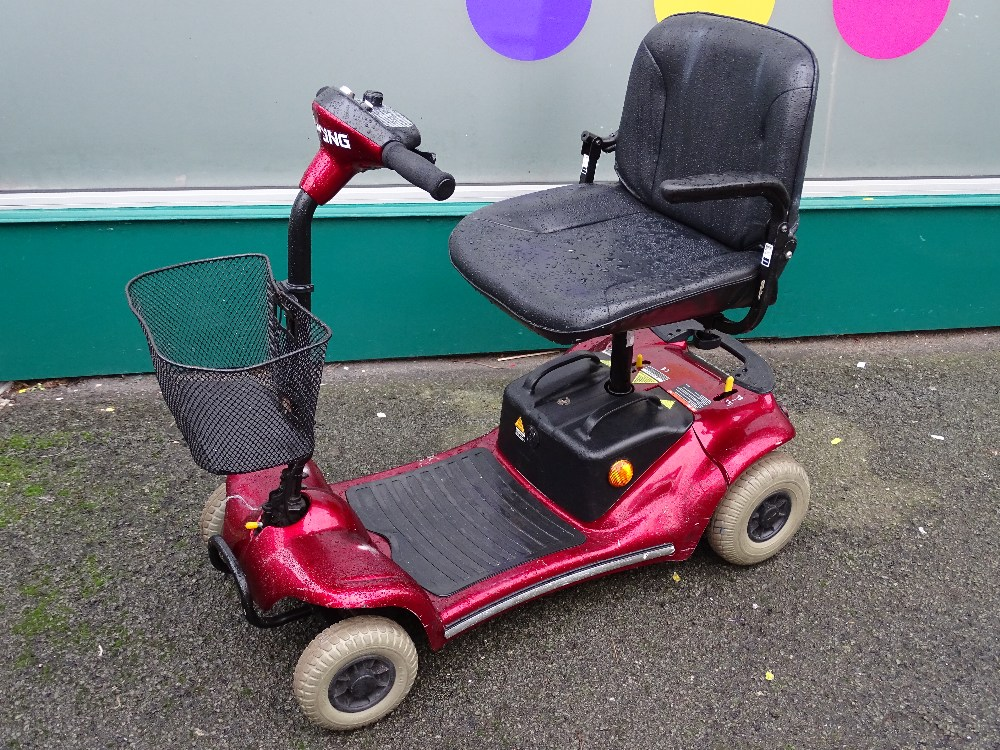 Lot 1 - Sterling Pearl motorized mobility scooter with charger and key E/T