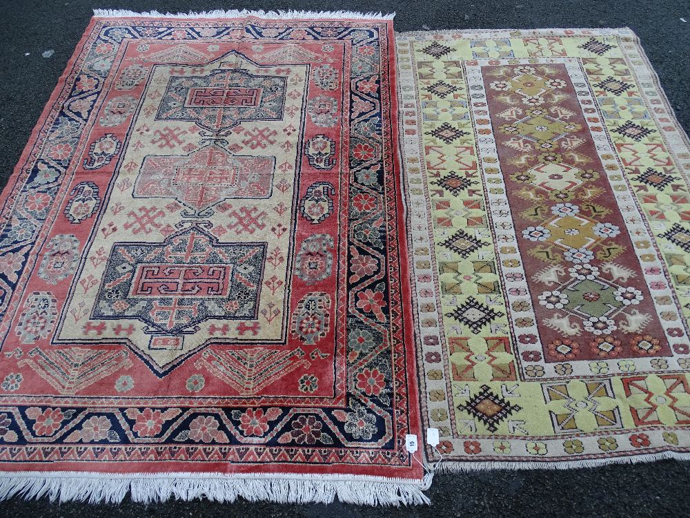 Lot 15 - Two vintage style tassel ended carpets