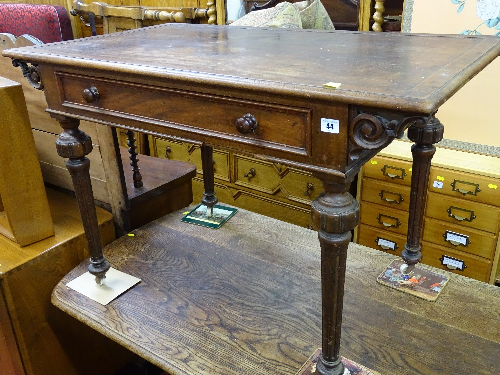 Lot 44 - Victorian mahogany single drawer writing table on turned and reeded supports