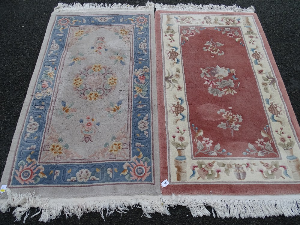 Lot 14 - Two Chinese washed woollen rugs