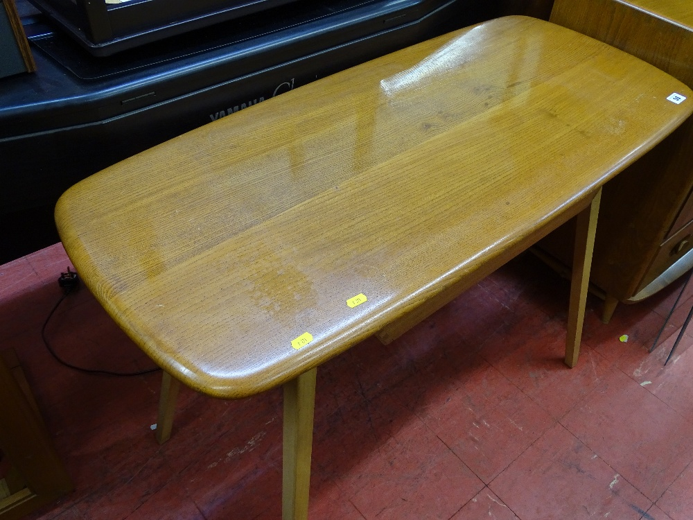 Lot 50 - Ercol mid oak slim table with under tier drawer