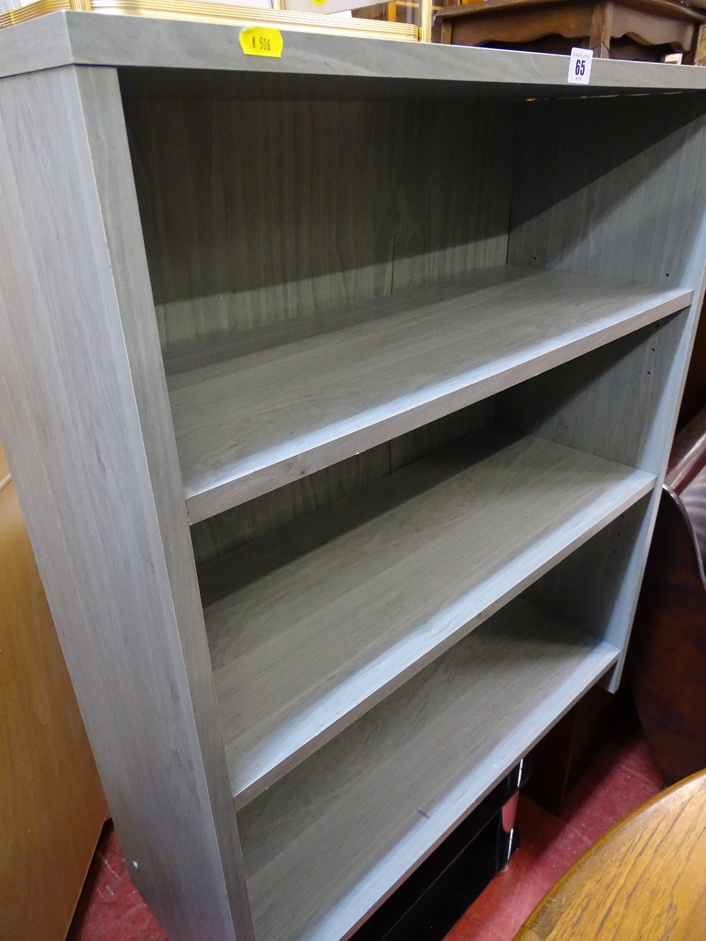 Lot 65 - Modern lime washed style adjustable bookcase and a glass and chrome TV stand