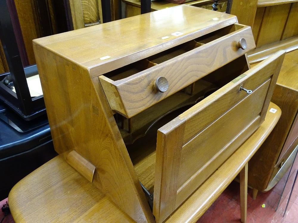 Lot 49 - Ercol mid oak portable tabletop bureau