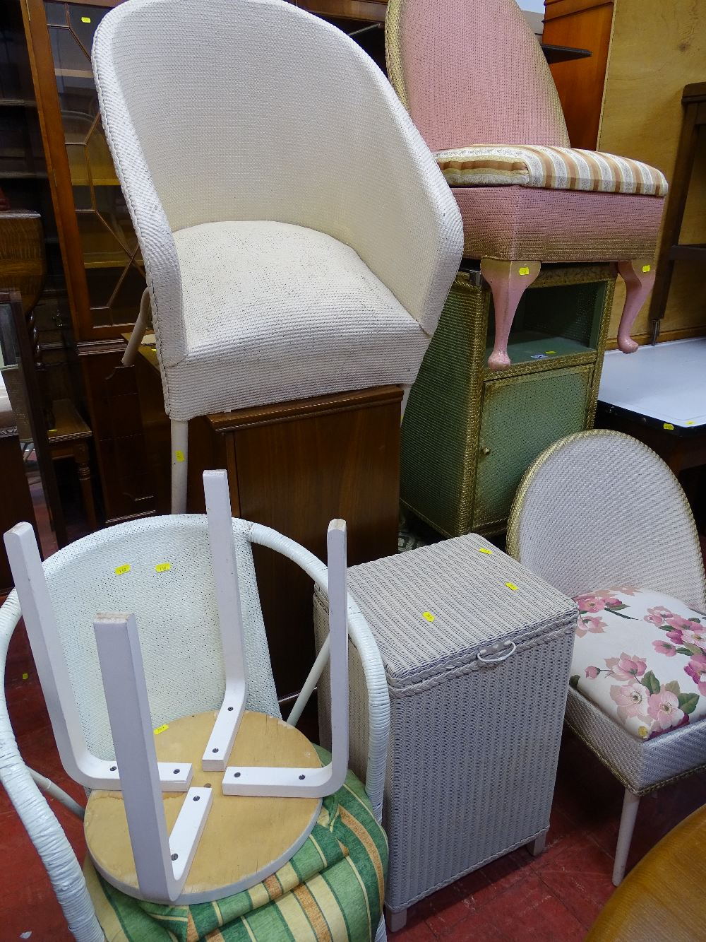Lot 54 - Seven items of Lloyd loom style furniture and a circular topped stool