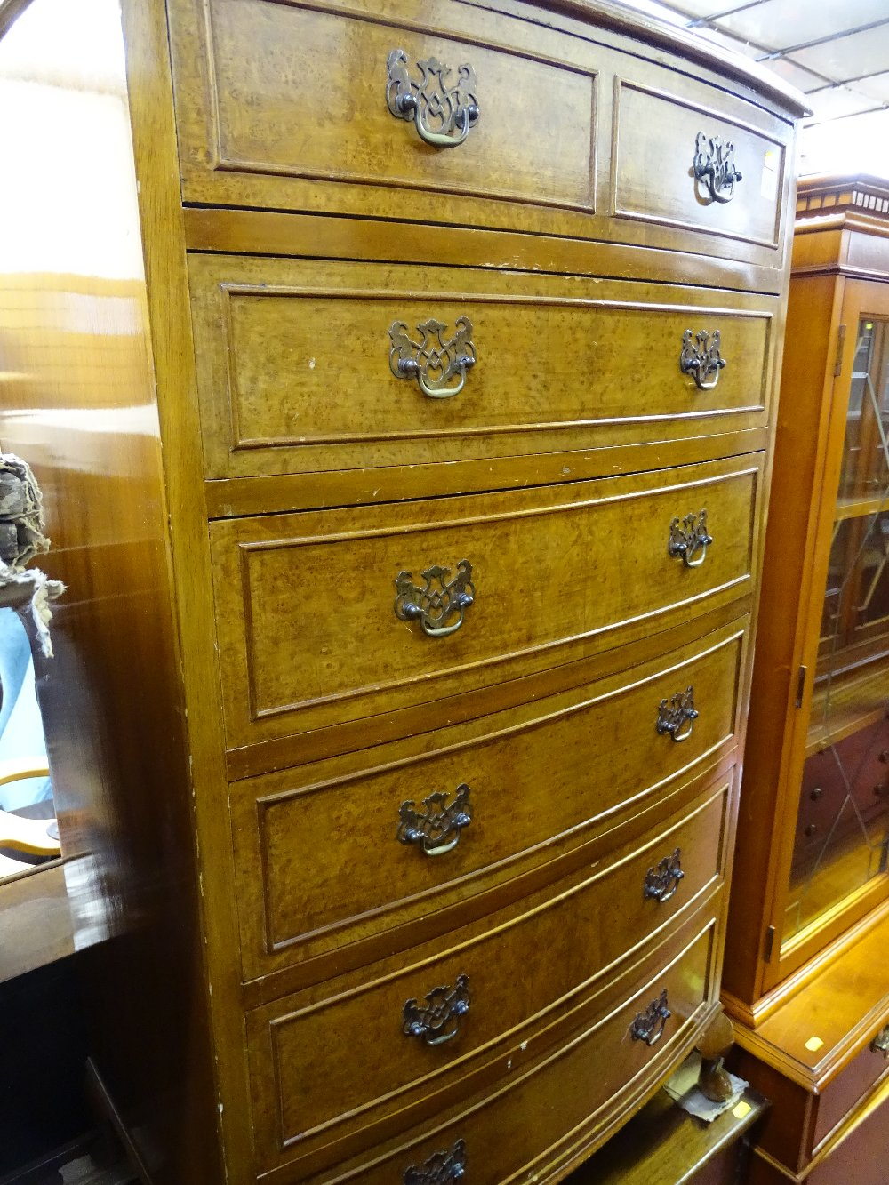 Lot 38 - Burr walnut bow fronted chest of six drawers