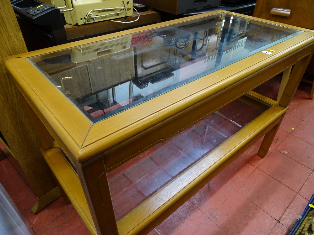 Lot 47 - Two reproduction light wood glass topped coffee tables