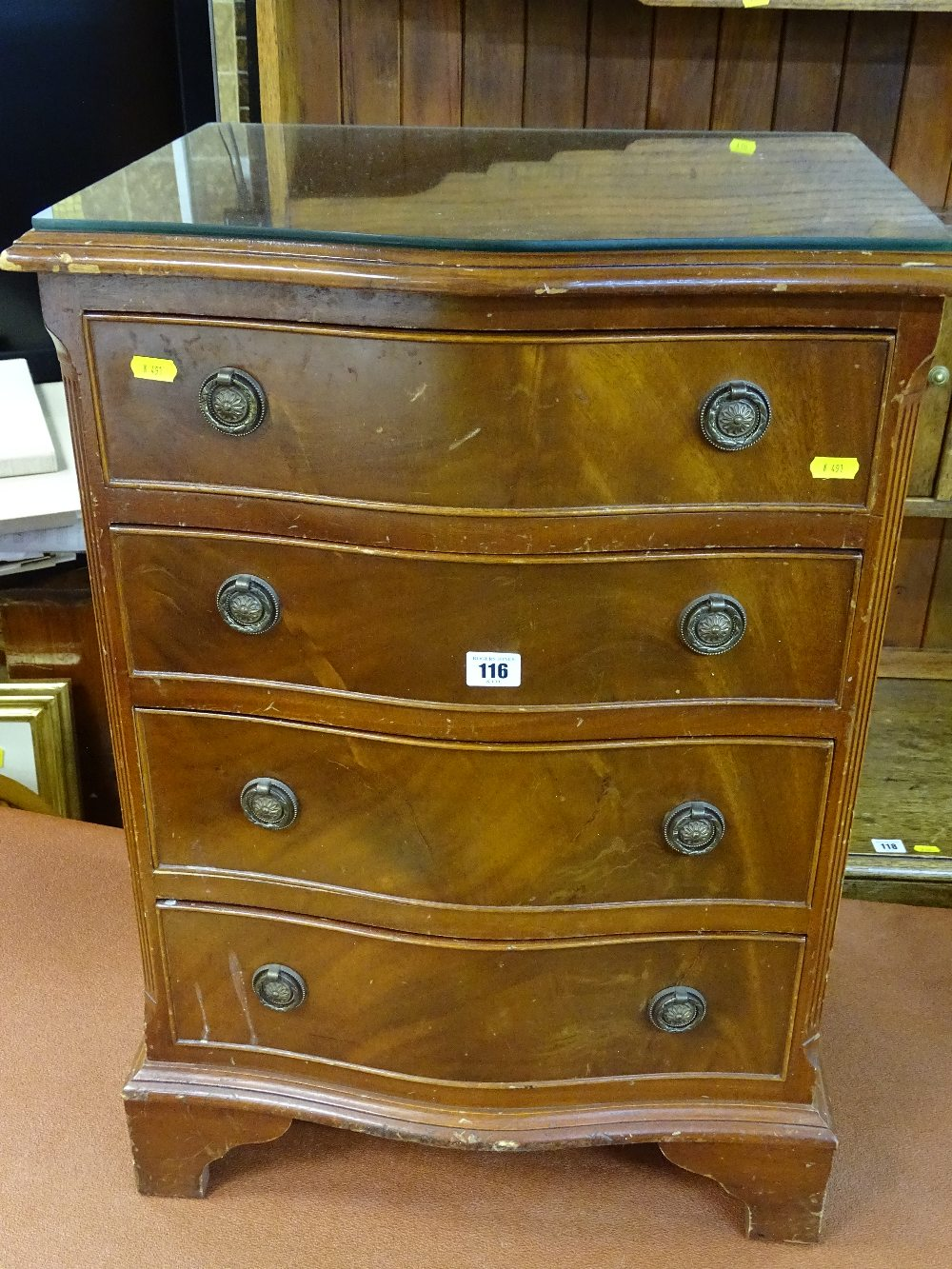 Lot 116 - Reproduction mahogany serpentine front four drawer chest