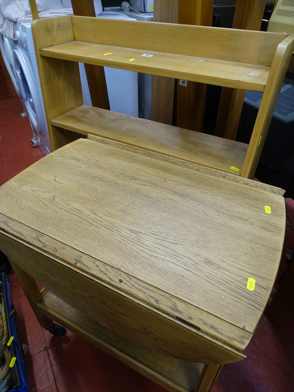 Stripped oak open bookcase and a twin flap two tier trolley