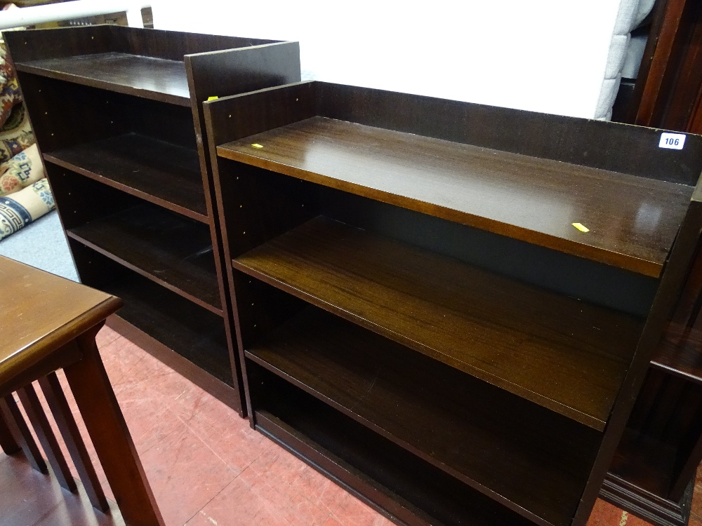 Lot 106 - Two sets of dark wood bookshelves with adjustable interior shelves