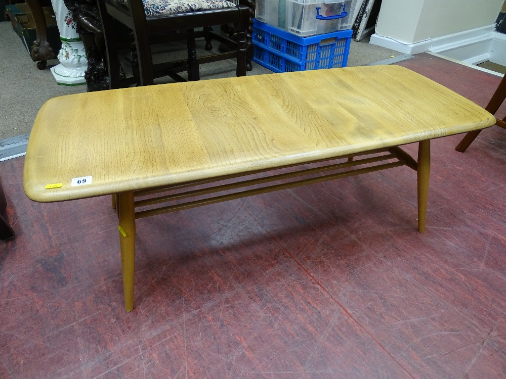Lot 69 - Ercol light wood coffee table with under tier spindle rack