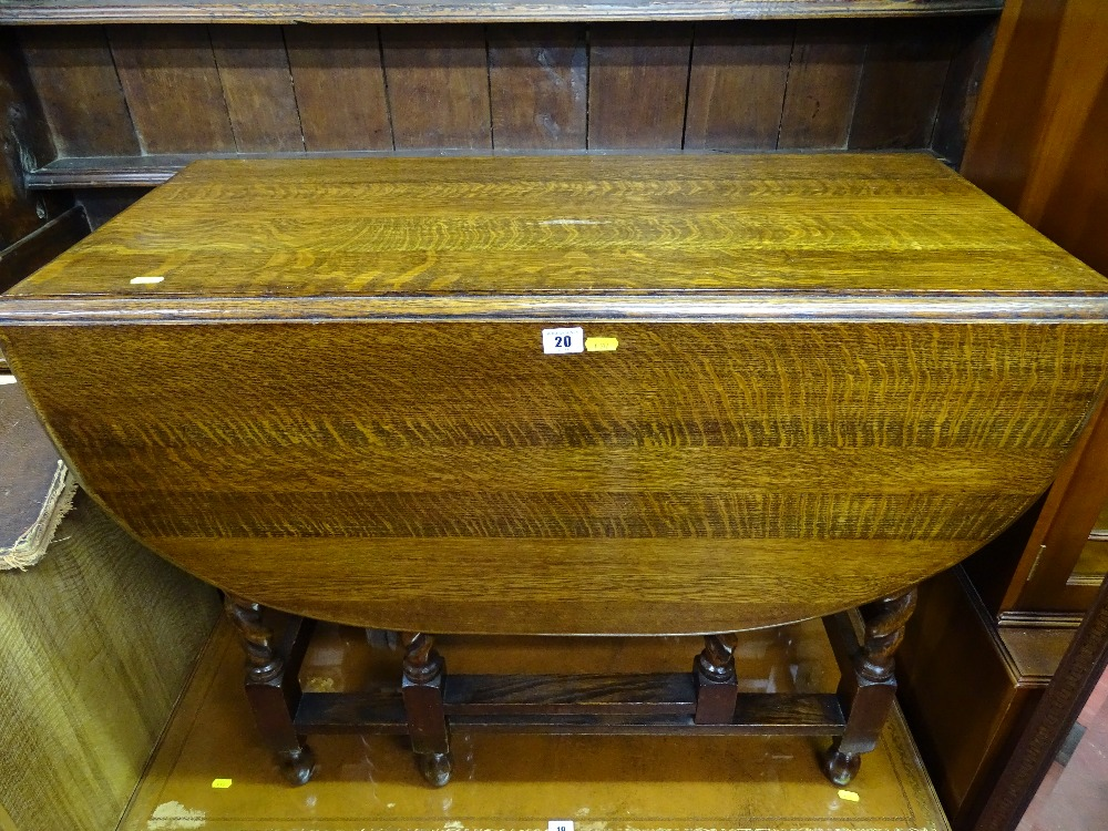 Lot 20 - Well presented oak barley twist gate leg dining table