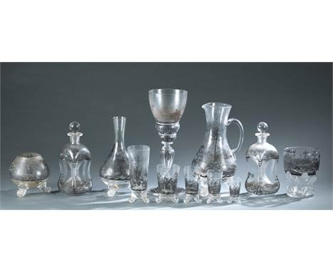 A group of ninety-three pieces of glass transfer swirl foot glassware. Glasses depict country landscape scenes with scrolled