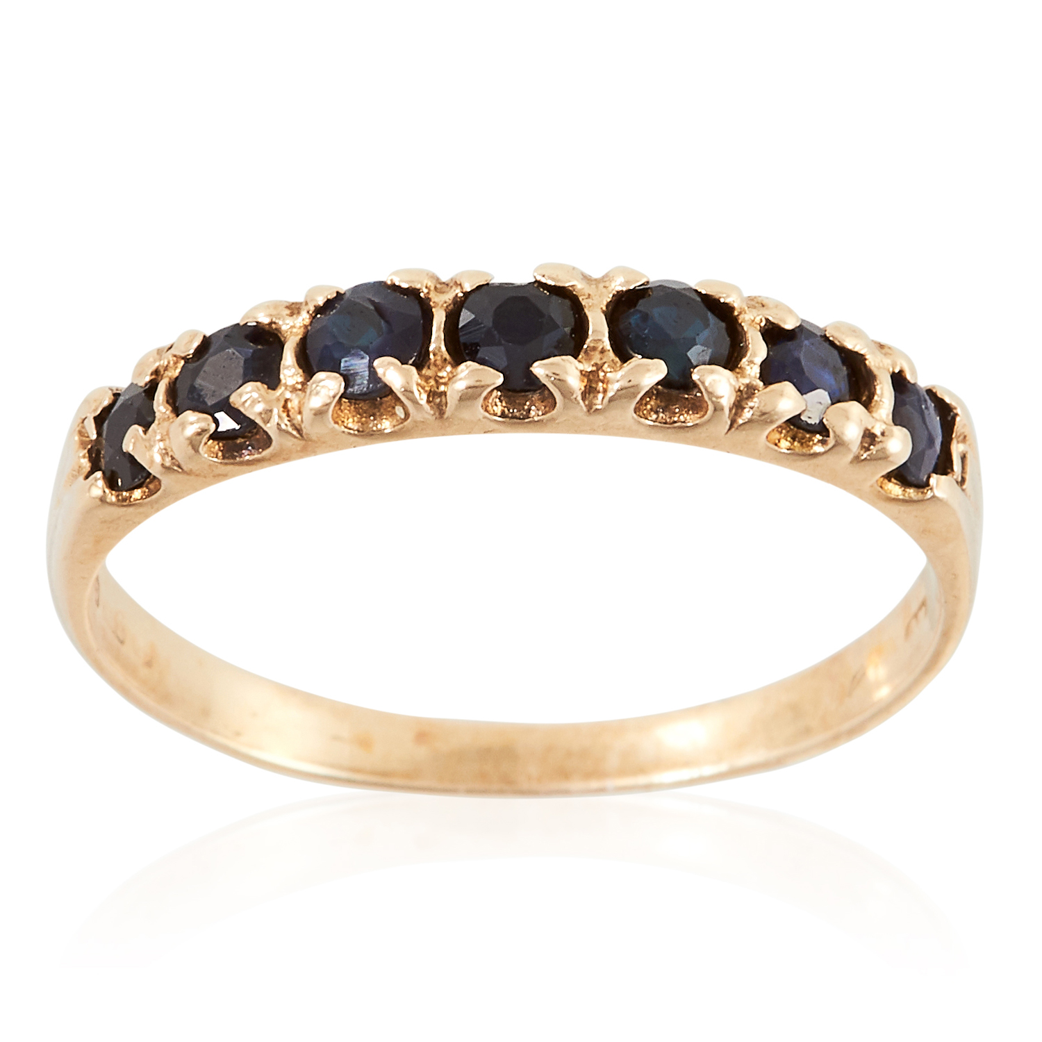 A SAPPHIRE ETERNITY RING in yellow gold, set with seven round cut sapphires, marked indistinctly,
