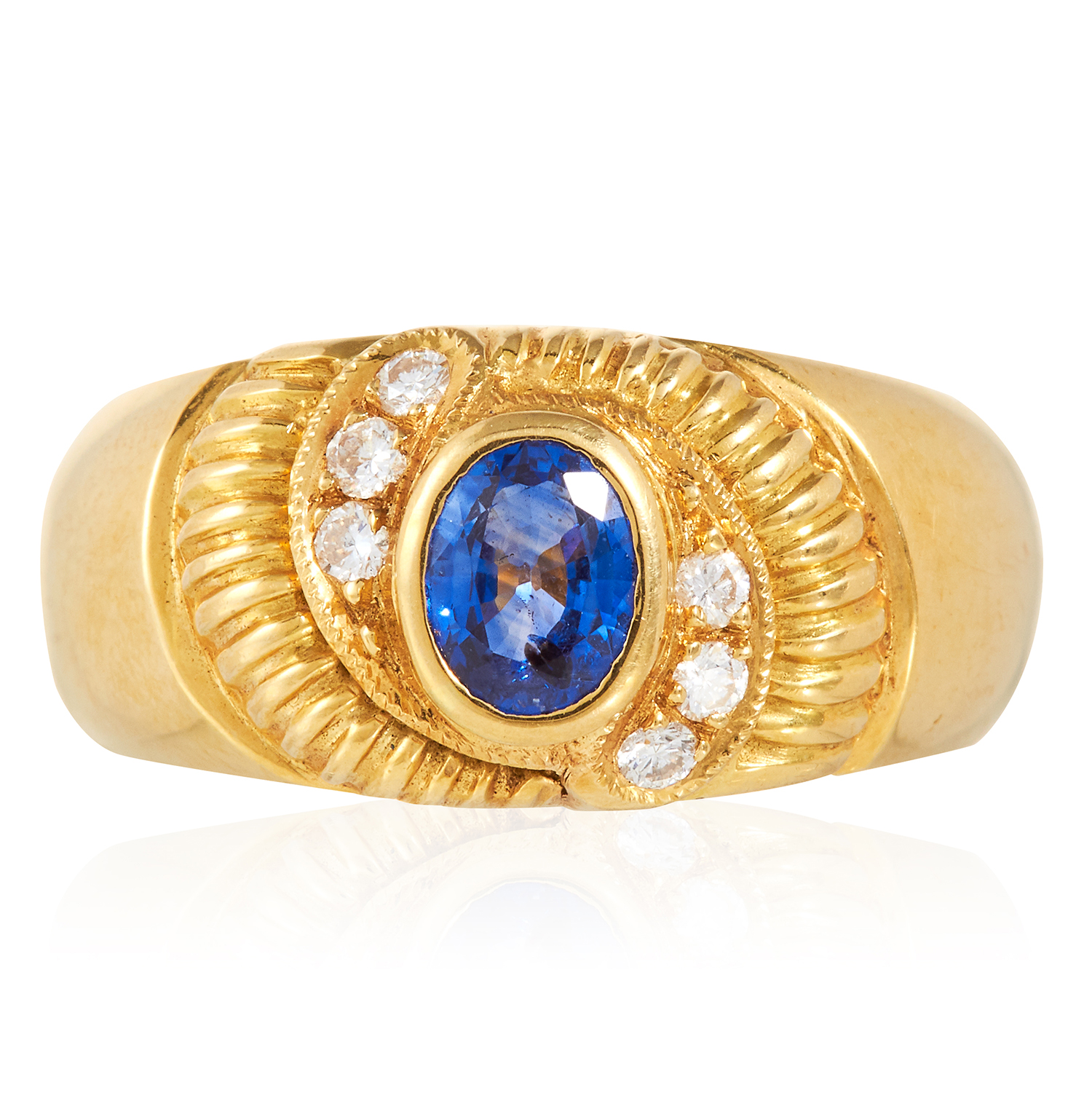 A SAPPHIRE AND DIAMOND DRESS RING in 18ct yellow gold, set with an oval cut Ceylon sapphire and