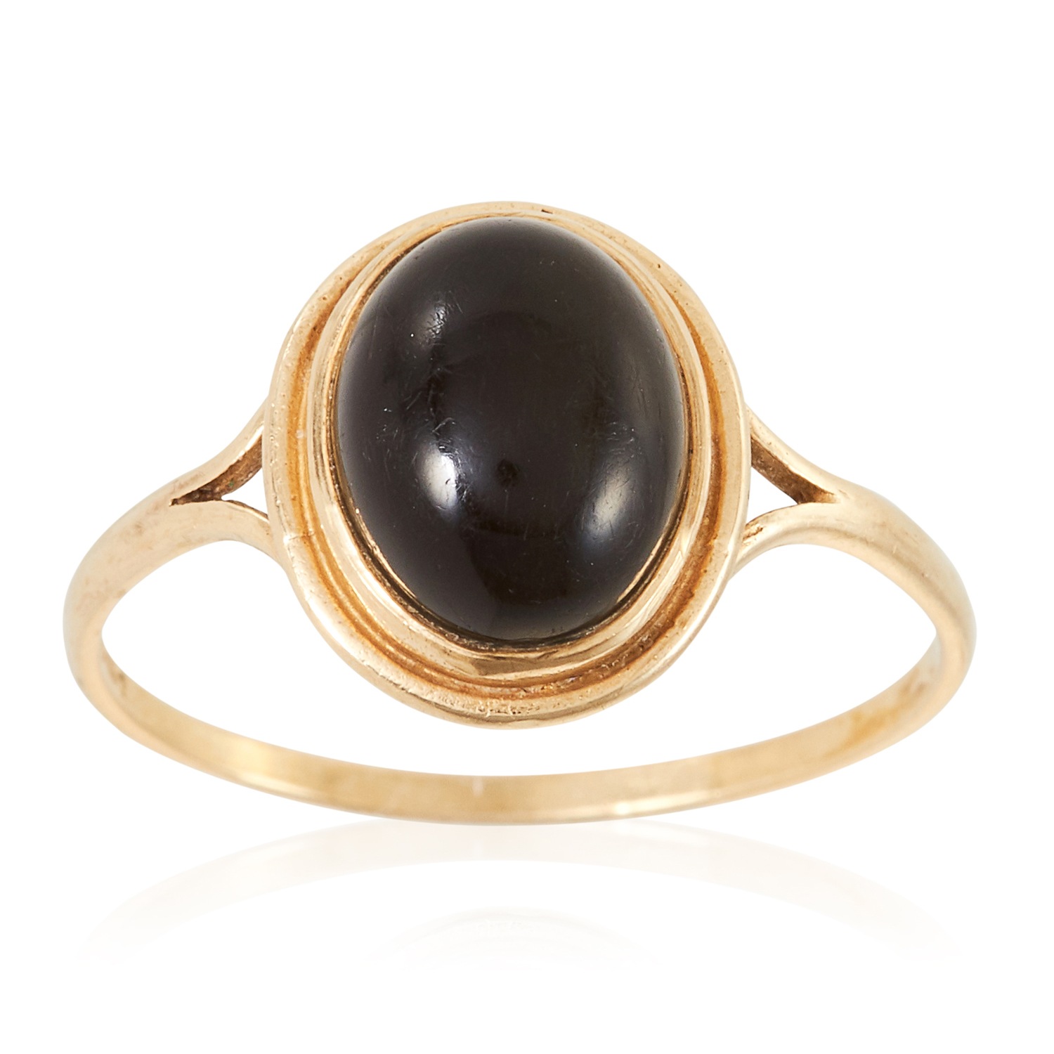 A GEMSET RING in yellow gold, set with a cabochon green stone, British hallmarks, size S / 9, 1.6g.