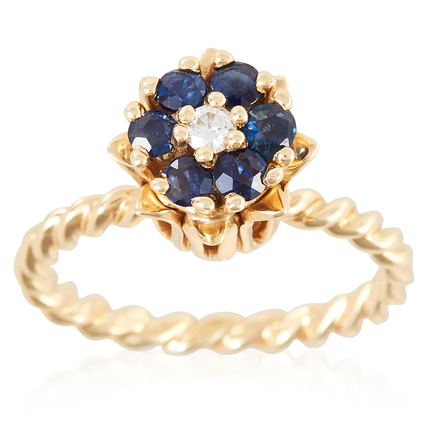 A SAPPHIRE AND DIAMOND CLUSTER RING in yellow gold, set with a round cut diamond and six round cut