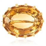 A CITRINE BROOCH in gold, set with an oval cut citrine, unmarked, 3.5cm, 20.93g.