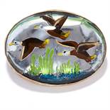 AN ENAMEL AND ROCK CRYSTAL BROOCH in sterling silver, depicting a scene of three ducks flying,