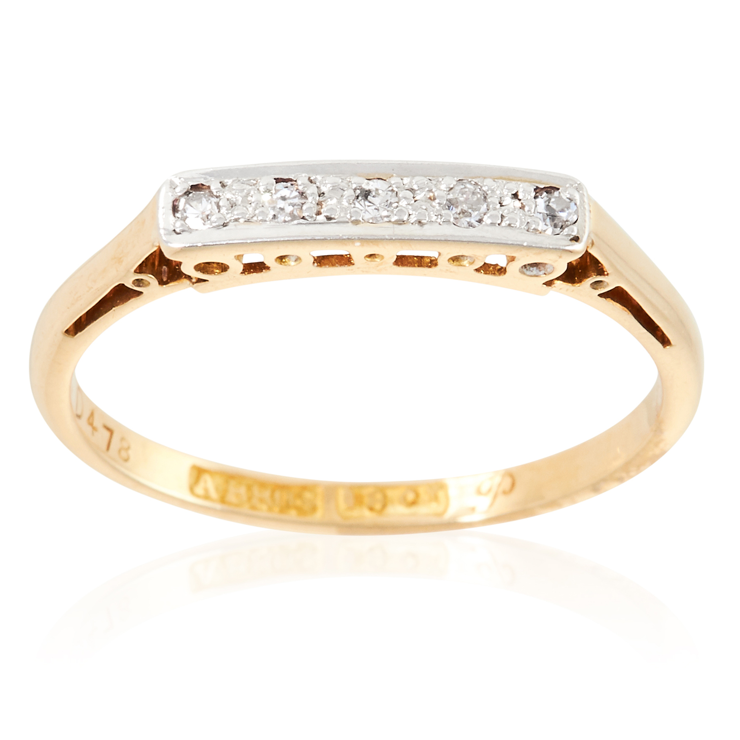 A DIAMOND DRESS RING in 18ct yellow gold, set with five round cut diamonds, stamped 18CT, size P /