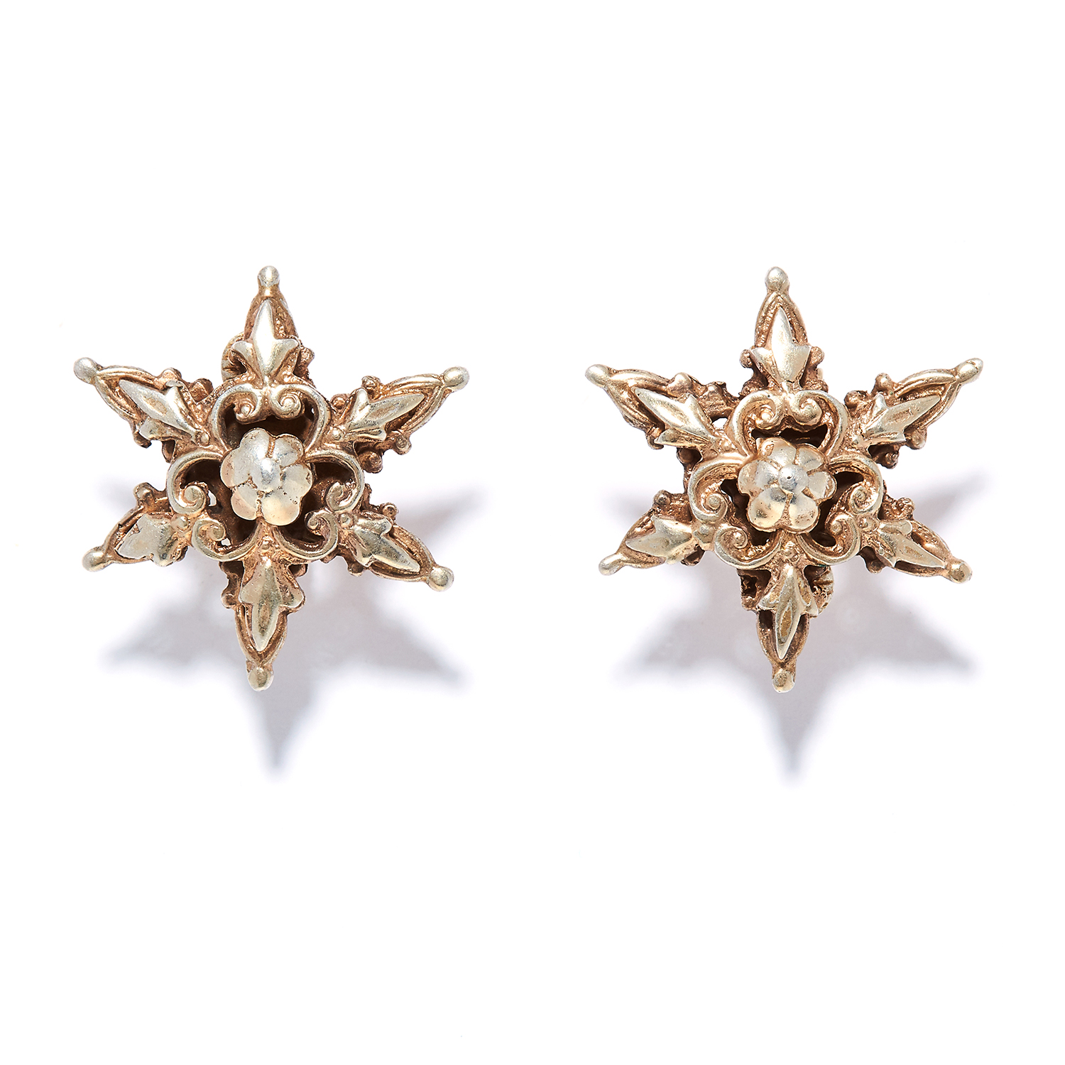 A PAIR OF SILVER EARRINGS in sterling silver, in star design, decorated with foliate motifs,