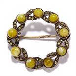 A GREEN HARD STONE AND MARCASITE BROOCH in sterling silver, in circular form, set with marcasite and