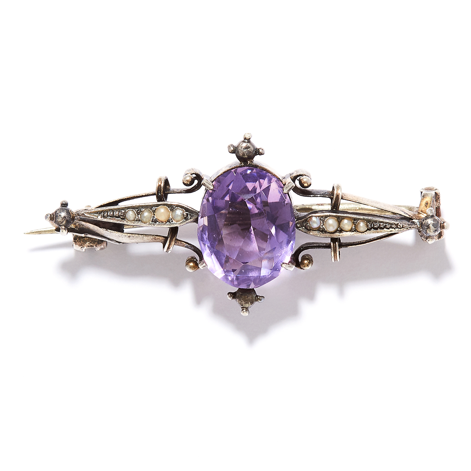 AN AMETHYST AND PEARL BROOCH in sterling silver, set with an oval cut amethyst between eight seed