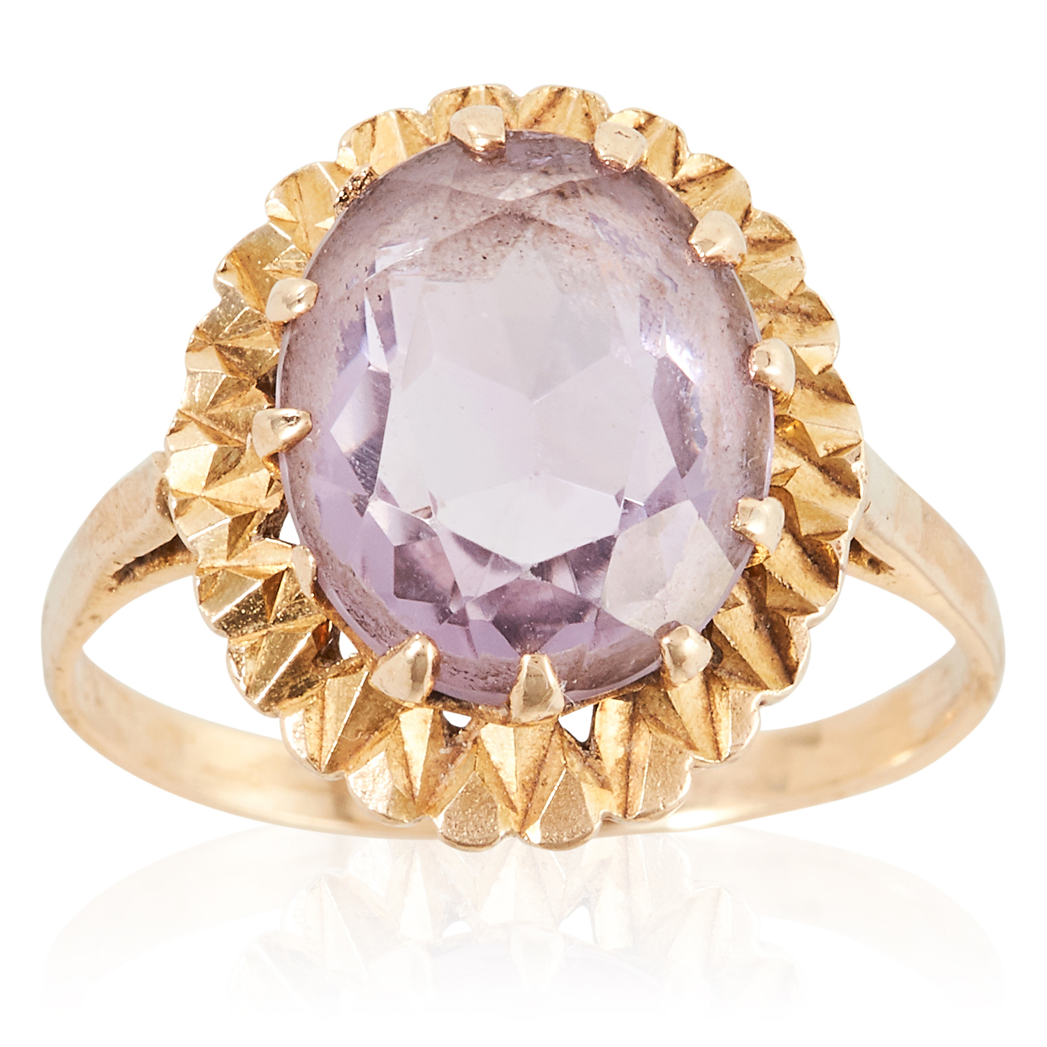 AN AMETHYST DRESS RING in yellow gold, set with an oval cut amethyst, stamped 9C, size R / 8.5, 4.