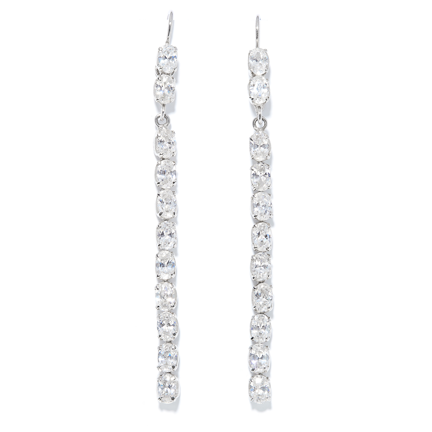 A PAIR OF WHITE STONE EARRINGS in white metal, each comprising of a line of oval cut white stones,