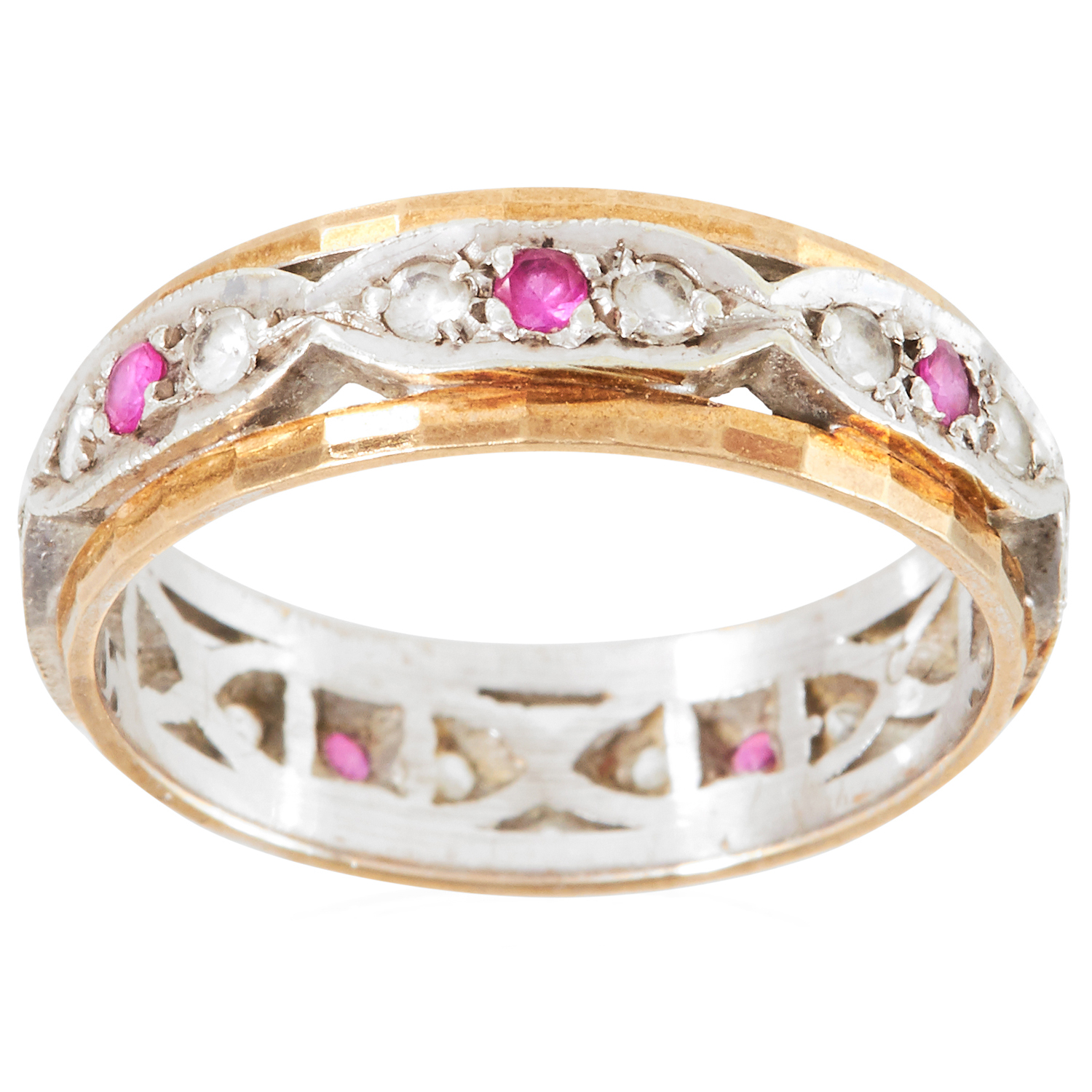 A RUBY AND DIAMOND ETERNITY RING in yellow gold, set with alternating round cut diamonds and rubies,
