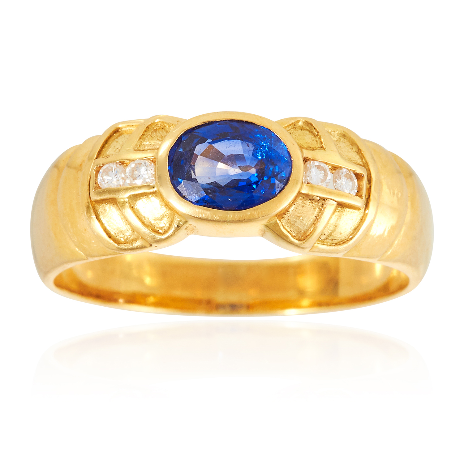 A SAPPHIRE AND DIAMOND DRESS RING in 18ct yellow gold, set with an oval cut Ceylon sapphire and four