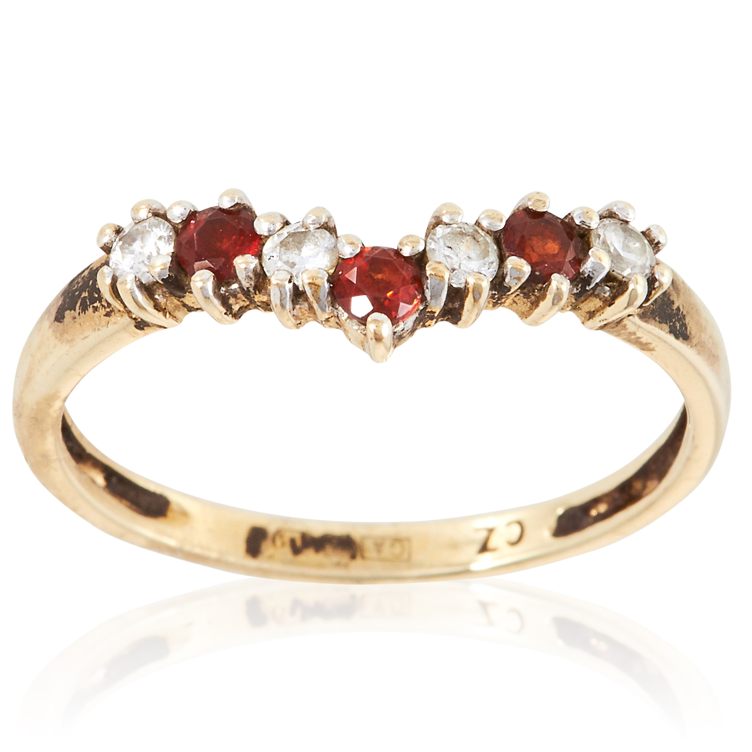 A GEMSET RING in yellow gold, set with alternating round cut red and white gemstones, unmarked, size