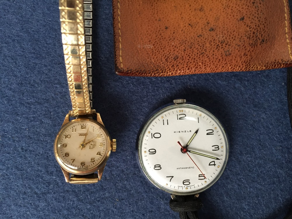 Lot 2 - A Tissot gilt metal ladies wristwatch together with a Kienzle pocket watch in a leather case (2)