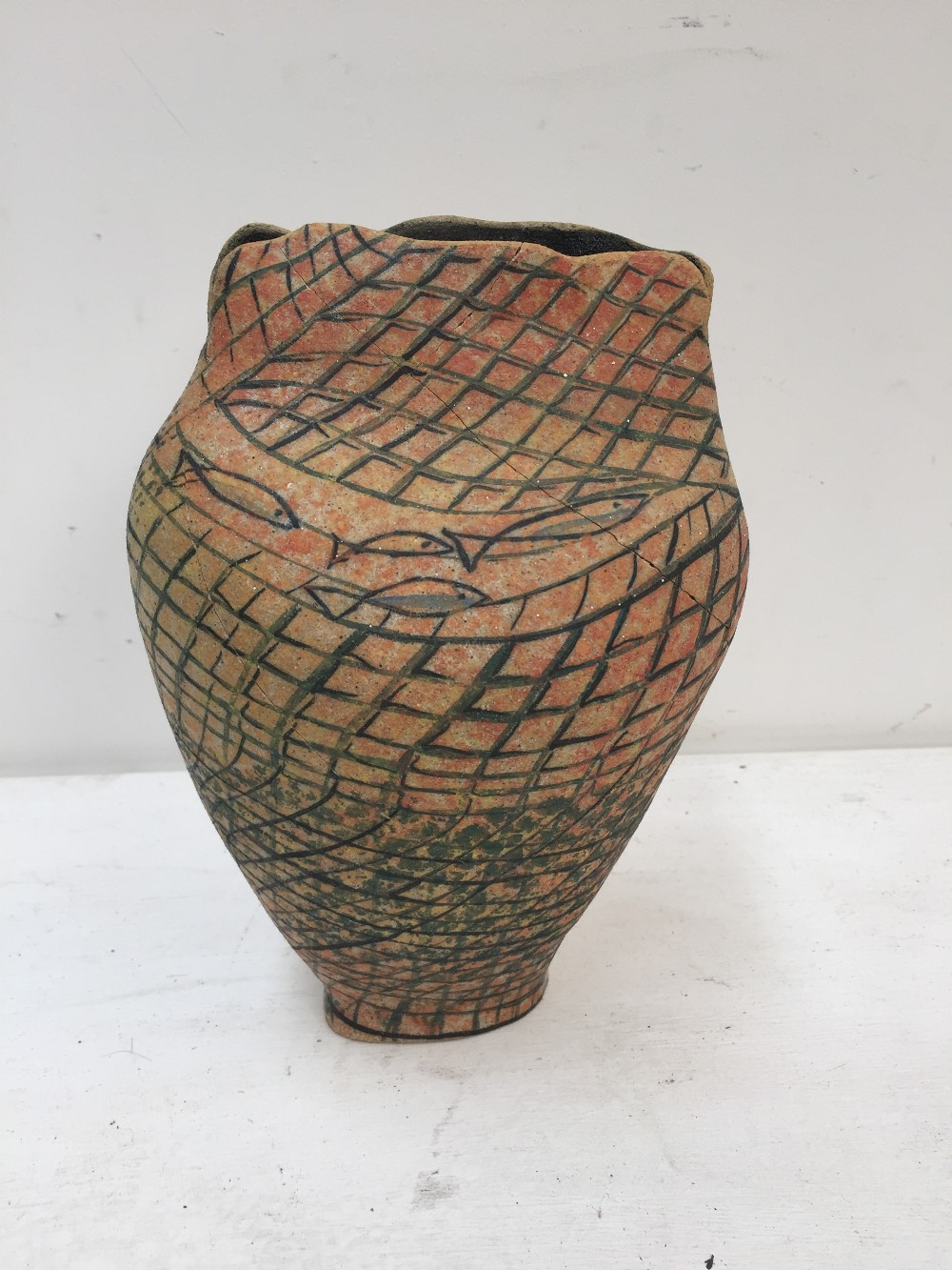 Lot 48 - LOCAL INTEREST: A Linda Browne pottery vase decorated with fishing motifs, 20cmH,
