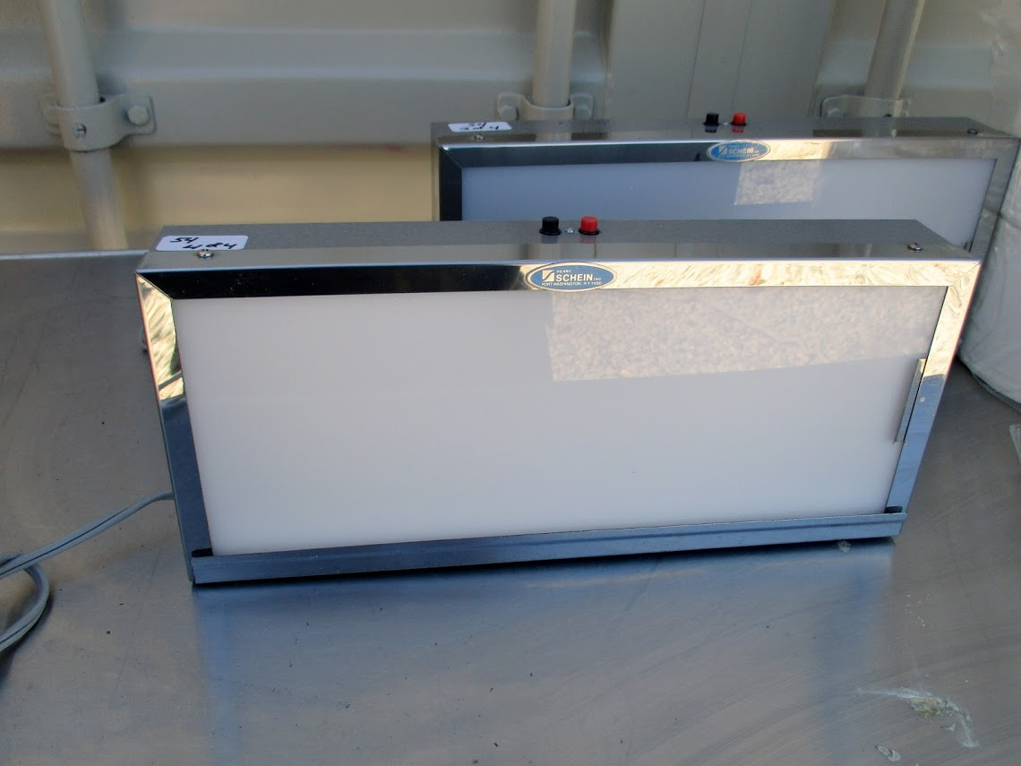 Lot 54 - ComfortSpa Model YS-701TM towel warmer with a case of new towel rolls. (2) Schein X-Ray viewers.